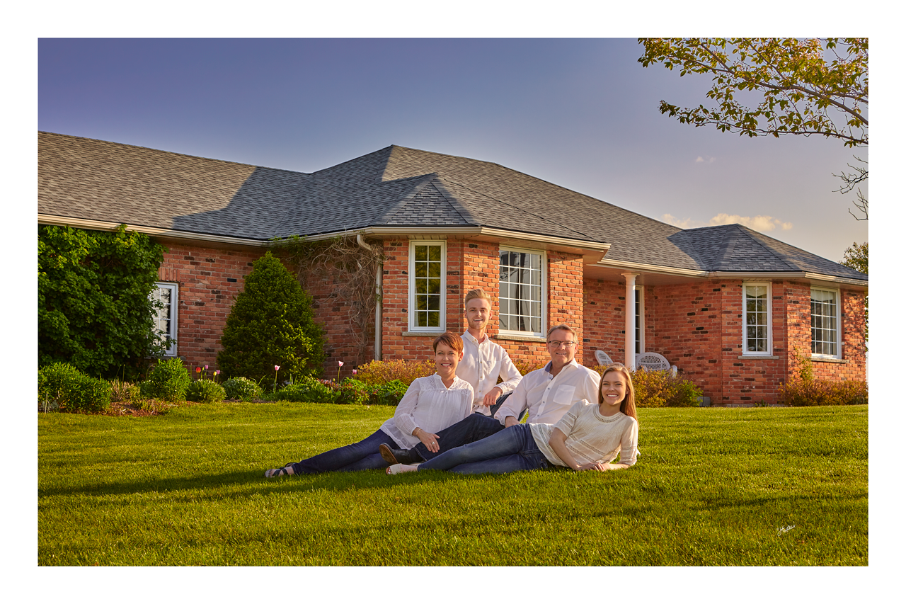 I recently had the honor of updating the portraits for a long time client. In this case the portrait of the entire family on the front lawn becomes the feature image.