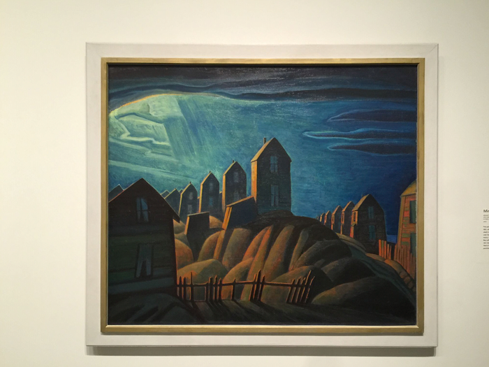 Coal Miner's Houses painted in Glace Bay in 1921 when Harris was in deep depression over his brother's death in the war. Although the houses have been distorted notice the repeating shapes, lines and colours and the opening in the heavens allowing the light to warm the houses.